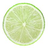 Slice of green lime. Isolated on white stock photo