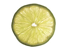 Slice of green lime. Small transparent slice of green lime Stock Photography