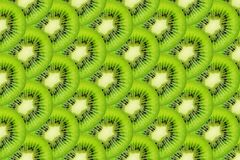 Slice of green raw kiwi fruit background.  stock images