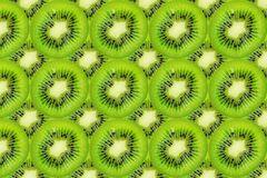 Slice of green raw kiwi fruit background.  stock photos