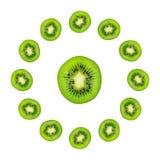 Slice of green raw kiwi fruit background, clock composition.  stock photos