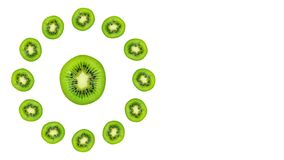 Slice of green raw kiwi fruit background, clock composition. Copy space stock photo
