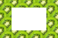 Slice of green raw kiwi fruit background, with copy space.  royalty free stock photos