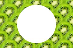Slice of green raw kiwi fruit background, with copy space.  royalty free stock images