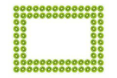Slice of green raw kiwi fruit background, frame and border, empty space.  royalty free stock photos