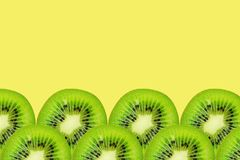 Slice of green raw kiwi fruit background, frame and border, empty space.  stock images