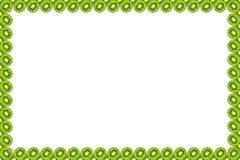 Slice of green raw kiwi fruit background, frame and border, empty space.  stock photo