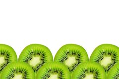 Slice of green raw kiwi fruit background, frame and border, empty space.  royalty free stock photography