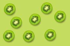 Slice of green raw kiwi fruit pattern background.  royalty free stock image