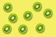 Slice of green raw kiwi fruit pattern background.  royalty free stock images