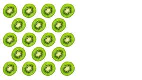 Slice of green raw kiwi fruit pattern background. Copy space stock photo