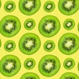 Slice of green raw kiwi fruit seamless pattern background.  stock images