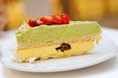 Slice of green tea cake Stock Photos