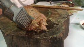 Slice grill steak on wooden board stock video
