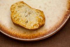 Slice of grilled baguette Stock Image