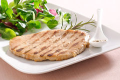 Slice of grilled pork with salad Stock Photo