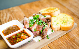 Slice Grilled pork with thai chilli sauce and garlic bread serve Royalty Free Stock Photography
