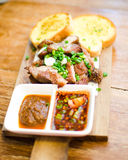Slice Grilled pork with thai chilli sauce and garlic bread serve Stock Photography