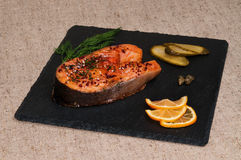 Slice of grilled salmon with Dijon mustard. Royalty Free Stock Photo