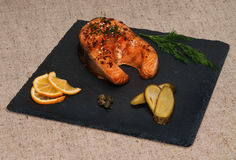 Slice of grilled salmon with Dijon mustard. Royalty Free Stock Photos