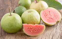 Slice of guava on wooden background Stock Photos
