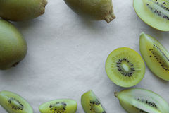 Slice half whole Gold Kiwifruit background Royalty Free Stock Photography