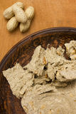 Slice of halva with peanuts Stock Photography