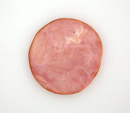 Slice of ham on a cutting board Stock Photos