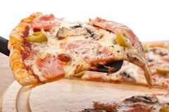 Slice of Ham and Mushrooms Pizza Lifted Up Royalty Free Stock Photos