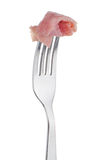 Slice of ham skewered on a fork Stock Images