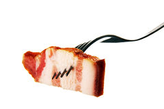 A slice of ham on a steel fork. Royalty Free Stock Image