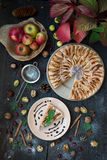 Slice of homemade apple pie with fresh apples Royalty Free Stock Images