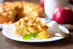 A slice of apple pie with ice cream royalty free stock image