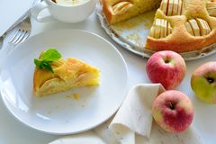 Slice of homemade apple pie on white plate. Tea time concept.  stock images