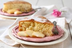 Slice of homemade apple sponge cake on pink plate Royalty Free Stock Photo