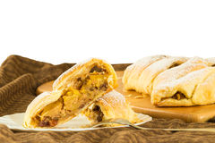 Slice of homemade apple strudel apples pie with puff pastry, cinnamon and raisin stock photos