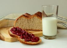 Slice of homemade bread spread with raspberry jam Royalty Free Stock Photo