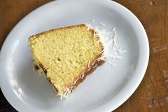Slice of homemade cake with coconut flakes stock image