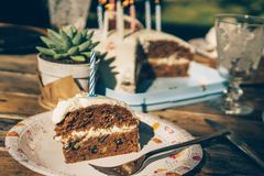 A slice of homemade carrot cake with a candle stock images