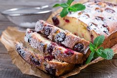 Slice of homemade cranberry cake with cherries, powdered sugar and mint. Homemade dessert Stock Photography
