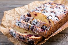 Slice of homemade cranberry cake with cherries and powdered sugar Stock Images