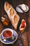 Slice of homemade fresh baguette with jam, plate with cheese, ja Stock Images