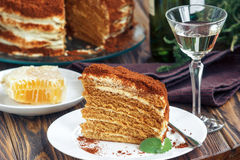 Slice of homemade layered honey cake with honeycomb and mint, traditional food of Jewish New Near. Sweet food Stock Photography