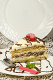 Slice of homemade nutty cake with strawberries and mint. Vertical format Royalty Free Stock Photo