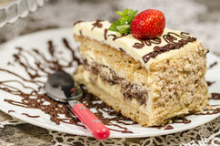 Slice of homemade nutty cake with strawberries served spoon Royalty Free Stock Images