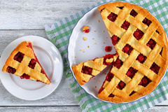 Slice of homemade sour cherry pie Stock Images