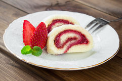 Slice of Homemade Sweet roll with Strawberry jam and berries Stock Image