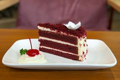 Slice of homemade velvet red cake  decorated with cream on white Royalty Free Stock Photography