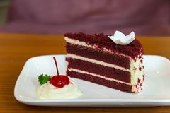 Slice of homemade velvet red cake  decorated with cream on white Stock Photos