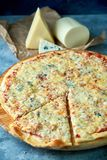 Slice of hot pizza large cheese lunch or dinner crust seafood meat topping sauce. with bell pepper vegetables delicious. Tasty fast food italian traditional on royalty free stock photos